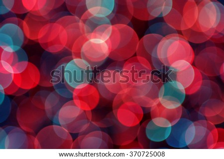 Defocused abstract multicolored bokeh lights background. Colourful festive multi colored circles. - stock photo