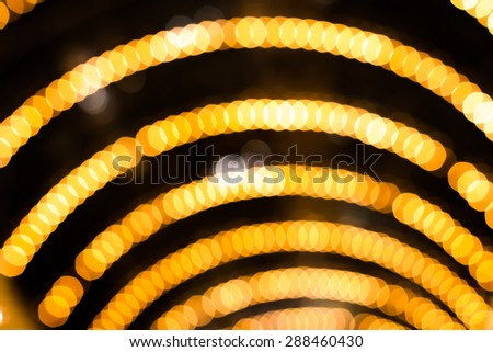 Defocused abstract yellow gold lights christmas arch background - stock photo
