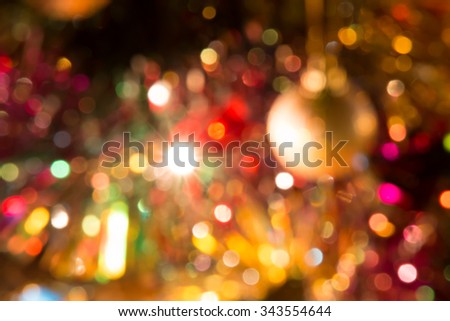 Defocused and blur Christmas light. Merry Christmas ornament decorate a gift,  christmas tree, and ribbon. - stock photo