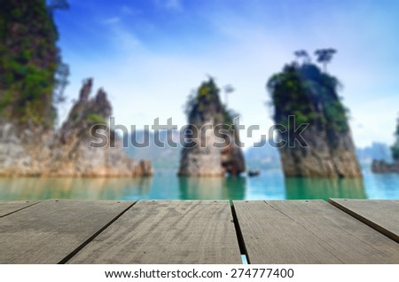 Defocused and blur image of terrace wood and beautiful Jetty walkway into the sea at Thailand for background usage - stock photo