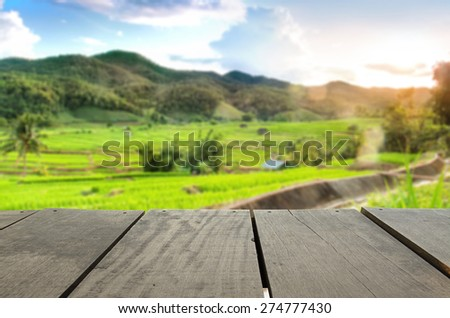 Defocused and blur image of terrace wood and terrace field and sunset time for background usage - stock photo