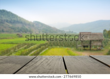 Defocused and blur image of terrace wood and terrace field and sunset time for background usage