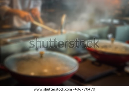 Defocused and blurred image for background of busy chef  - stock photo