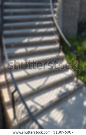 Defocused and blurred image for background of modern stairs into garden