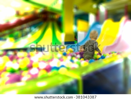 Defocused and blurred image of a for background children playground, children's indoor amusement