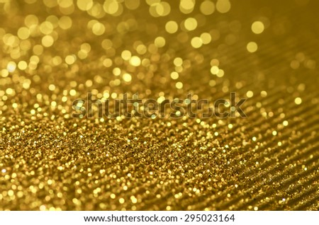Defocused and colorized luxurious glittering background / Glittering background / Ideal for festive season, holiday and party celebration promotions - stock photo
