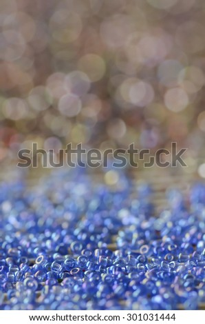 Defocused and colorized luxurious glittering background / Glittering background / Ideal for festive season, holiday, party and birthday celebrations - stock photo
