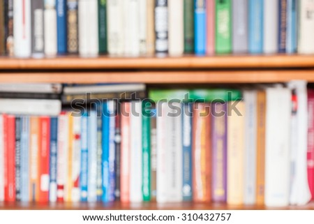 defocused background from many books on bookshelf