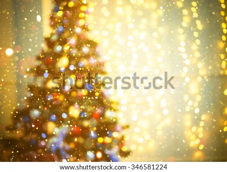 Defocused background Living room with christmas tree and glitter lights - stock photo
