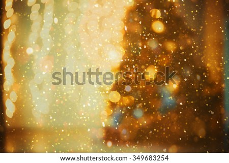 Defocused background Living room with christmas tree and glitter lights
