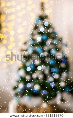Defocused background Living room with christmas tree and snow - stock photo