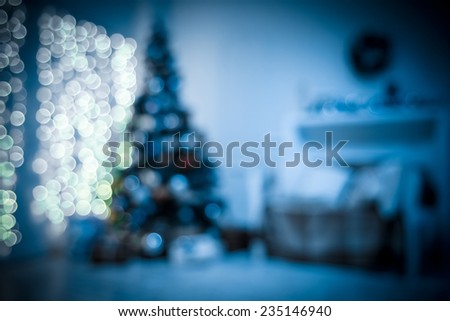 Defocused background Living room with christmas tree. Bllue toned - stock photo