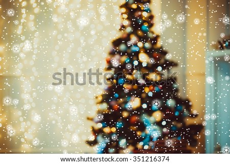 Defocused background Living room with christmas tree, stars and snow - stock photo