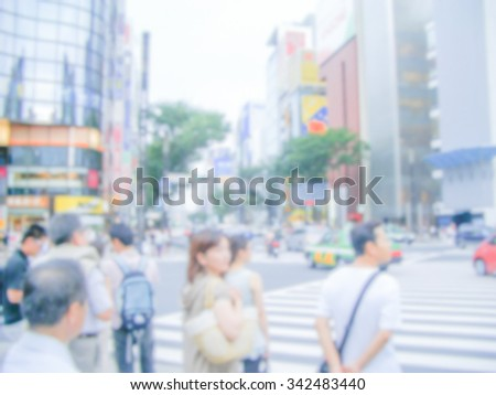 Defocused background of a crossroad in Tokyo, Japan. Intentionally blurred post production for bokeh effect - stock photo