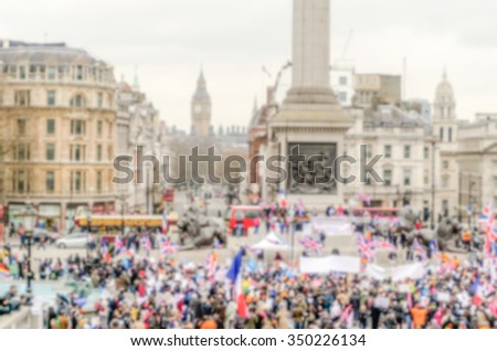 Defocused background of a crowded Trafalgar Square in London. Intentionally blurred post production for bokeh effect - stock photo