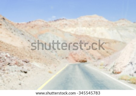 Defocused background of a hot Desert Road in Death Valley National Park, California. Intentionally blurred post production for bokeh effect