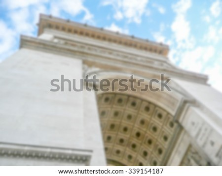 Defocused background of Arc de Triomphe in Paris, France. Intentionally blurred post production for bokeh effect