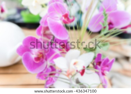 Defocused background of beautiful pink phalaenopsis orchids. Intentionally blurred post production for bokeh effect - stock photo