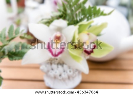 Defocused background of beautiful white phalaenopsis orchids. Intentionally blurred post production for bokeh effect - stock photo
