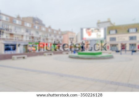 Defocused background of central Dover, UK. Intentionally blurred post production for bokeh effect - stock photo
