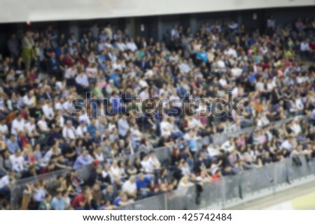 Defocused background of crowd of people in a basketball court - stock photo