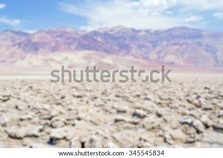 Defocused background of Devil's Golf Course in Death Valley, California. Intentionally blurred post production for bokeh effect - stock photo