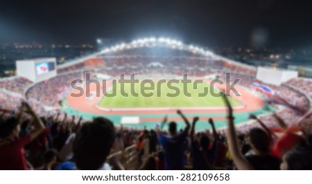 defocused background of soccer or football stadium at twilight,Thailand