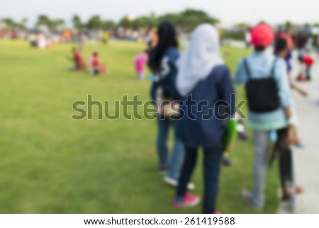 Defocused background of summer park with people.