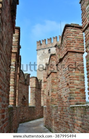 Defocused background of the medieval castle in Verona, Castelvecchio; intentionally blurred effect. Italy.