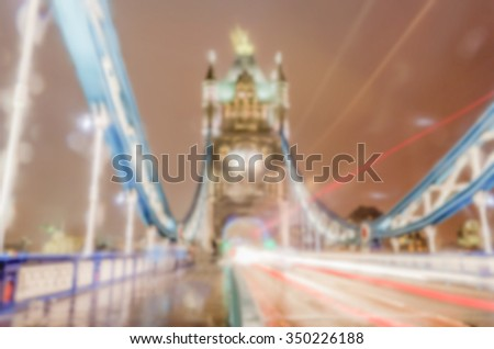 Defocused background of Tower Bridge at night in London. Intentionally blurred post production for bokeh effect - stock photo
