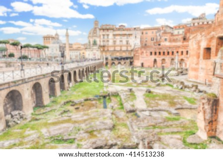 Defocused background with ancient Trajan's Market, ruins in Via dei Fori Imperiali, Rome, Italy. Intentionally blurred post production for bokeh effect