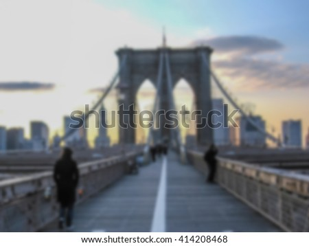 Defocused background with Brooklyn at sunset in New York, United States. Intentionally blurred post production for bokeh effect.