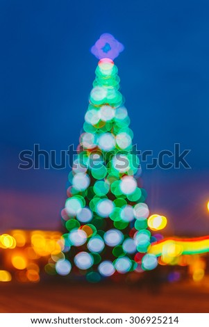 Defocused Blue Bokeh Background Effect. Design Backdrop. New Year Boke Lights Xmas Christmas Tree And Festive Illumination - stock photo