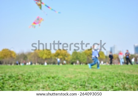 Defocused blur abstract background of kids playing in park - stock photo