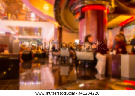 Defocused blur at elegant restaurant setting - stock photo