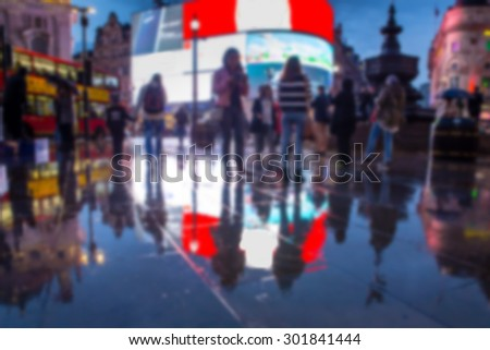Defocused blur of lights, people and reflections at night in Piccadilly Circus, London  - stock photo