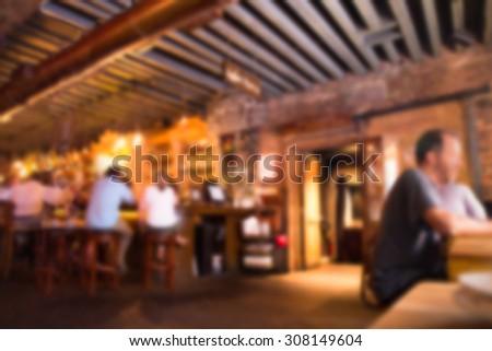 Defocused blur of scene inside restaurant pub and bar - stock photo