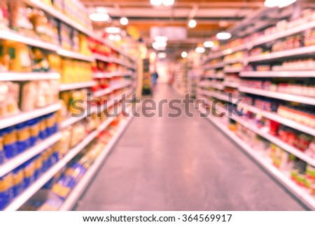 Defocused blur of supermarket pasta products - Food and consumerism concept - Marsala filtered look - Defocused image -