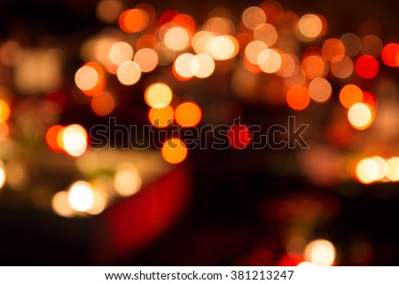 Defocused (blurry, bokeh) candle lights in a cemetery. For background.