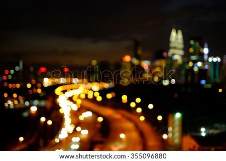 Defocused bokeh light of Kuala Lumpur night scenery. - stock photo