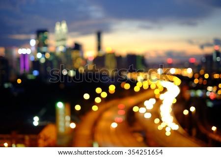 Defocused bokeh light of Kuala Lumpur night scenery during blue hour. - stock photo