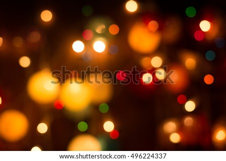 defocused bokeh of Christmas lights background.