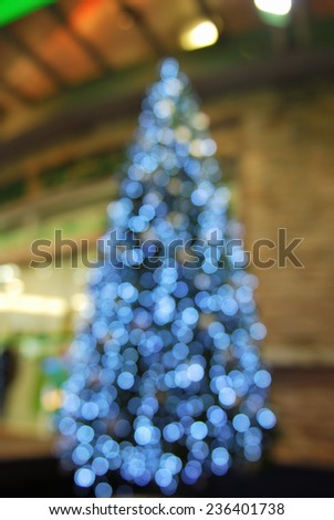 Defocused bokeh of christmas tree decoration - stock photo