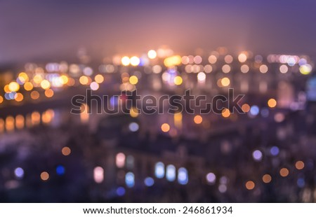 Defocused bokeh of Prague and Vltava river from Letna Hill - Romantic view after misty sunset with emotional color filter - European capital of bohemian Czech Republic - stock photo