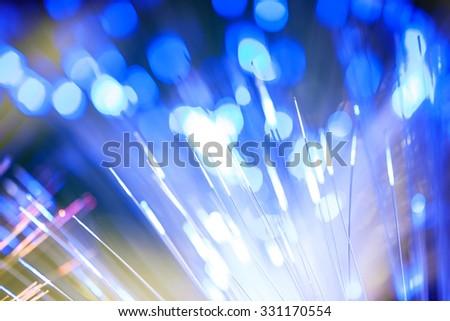 Defocused Brightly Lit Fiber Optics - stock photo