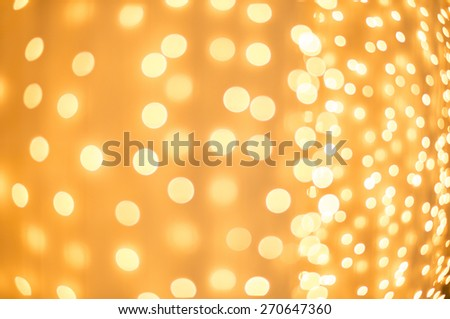 Defocused Christmas lights decoration in golden color. - stock photo