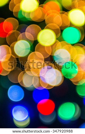 defocused christmas tree lights in a city background - stock photo