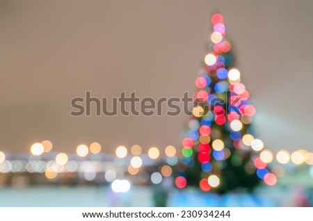 Defocused christmas tree silhouette with blurred lights - stock photo