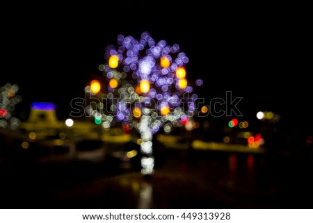 Defocused christmas tree with colorful lights - stock photo