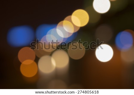 Defocused city lights with reflections on the water. - stock photo